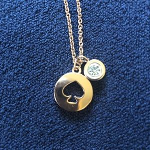 Kate Spade rose gold colored necklace